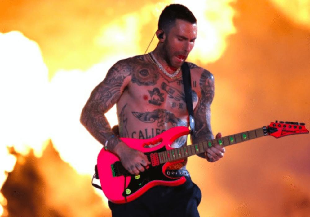 Adam Levine Takes His Shirt Off