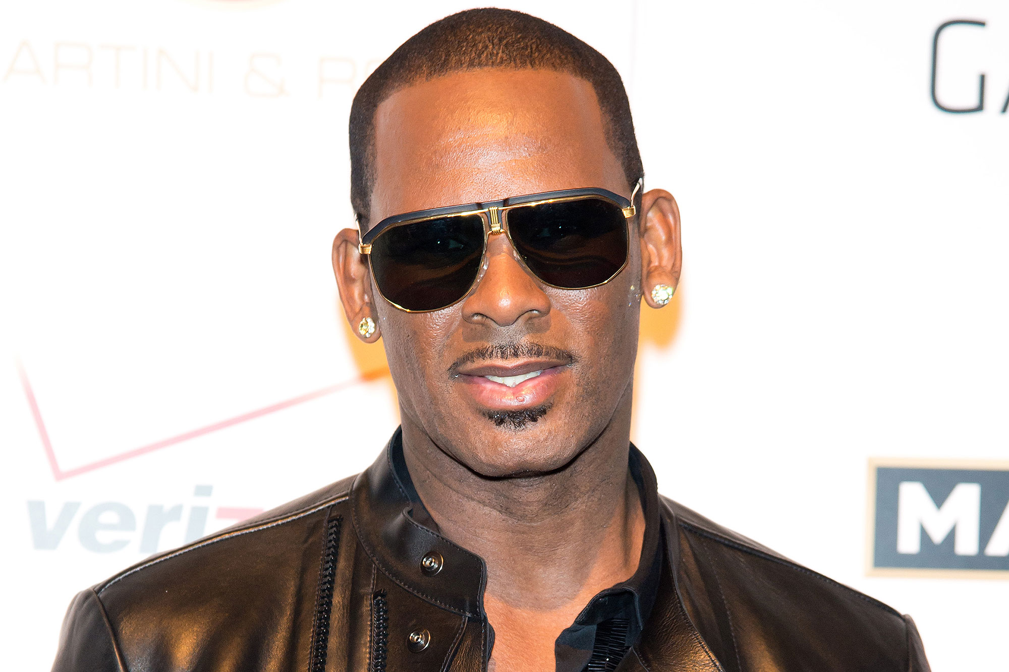"""r-kelly-gets-charged-with-no-less-than-ten-counts-of-criminal-sexual-abuse"""
