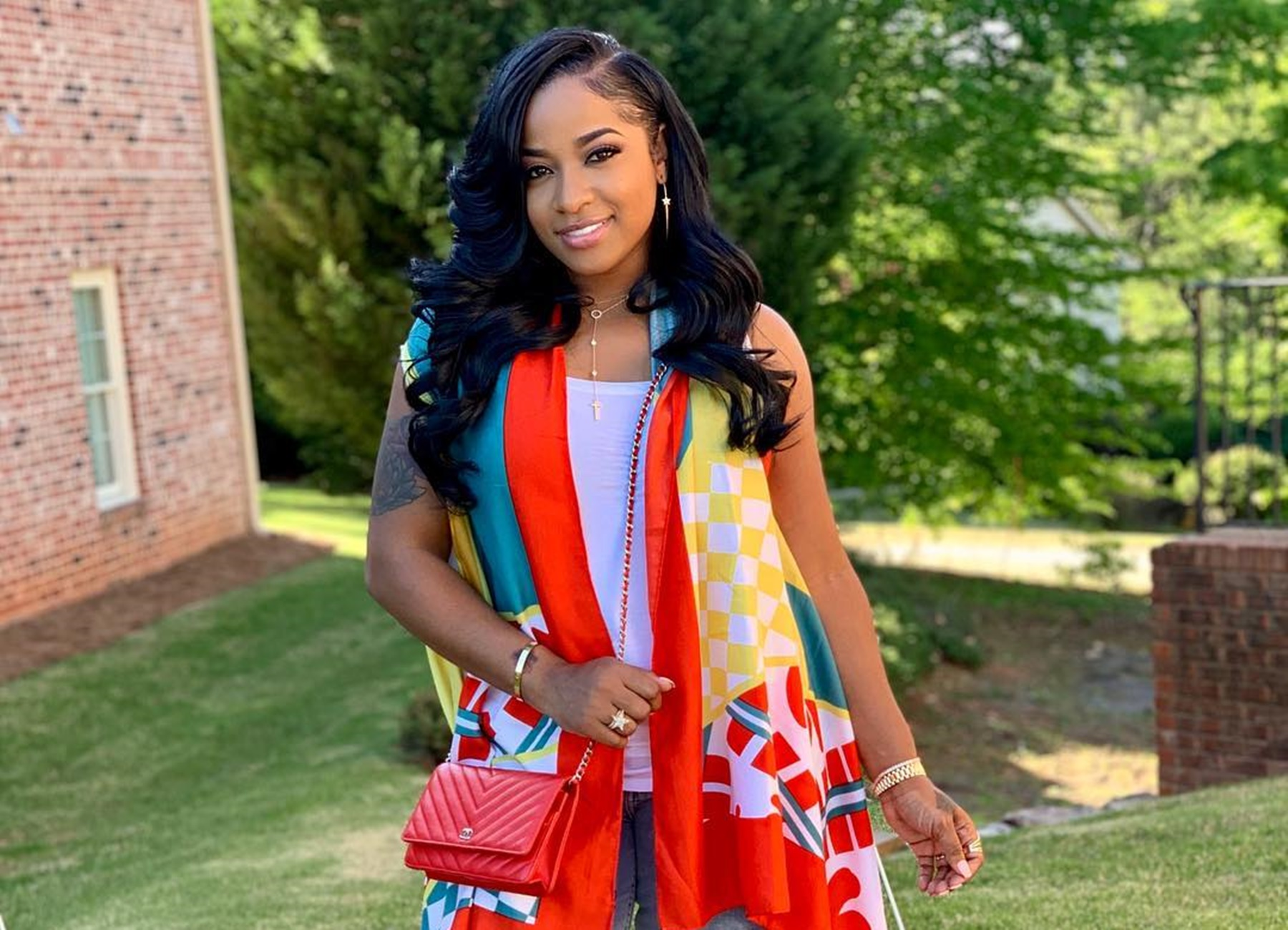 """toya-wright-steps-out-to-support-t-i-in-gorgeous-outfit-fans-spotted-a-ring-in-the-picture-and-believe-robert-rushing-proposed-to-reginae-carters-mother"""