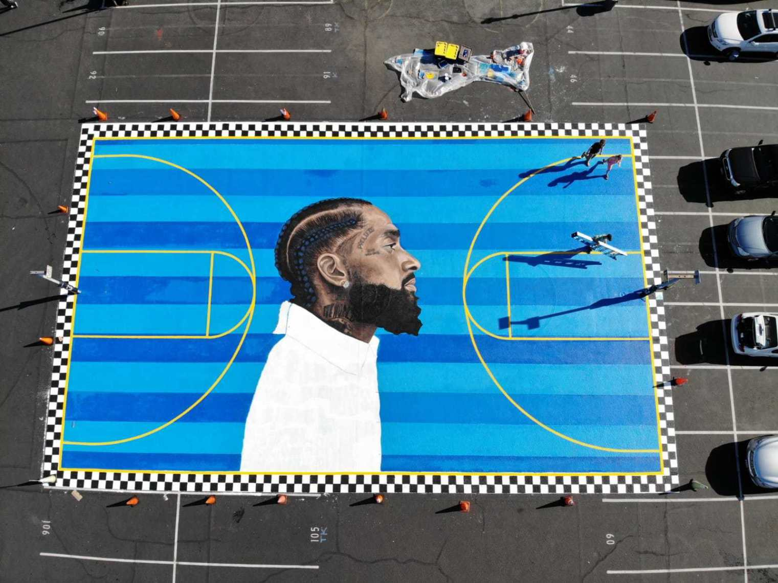 """nipsey-hussle-the-highest-human-act-is-to-inspire-see-the-emotional-videos-of-nips-basketball-court-mural-unveiled-at-crete-academy"""