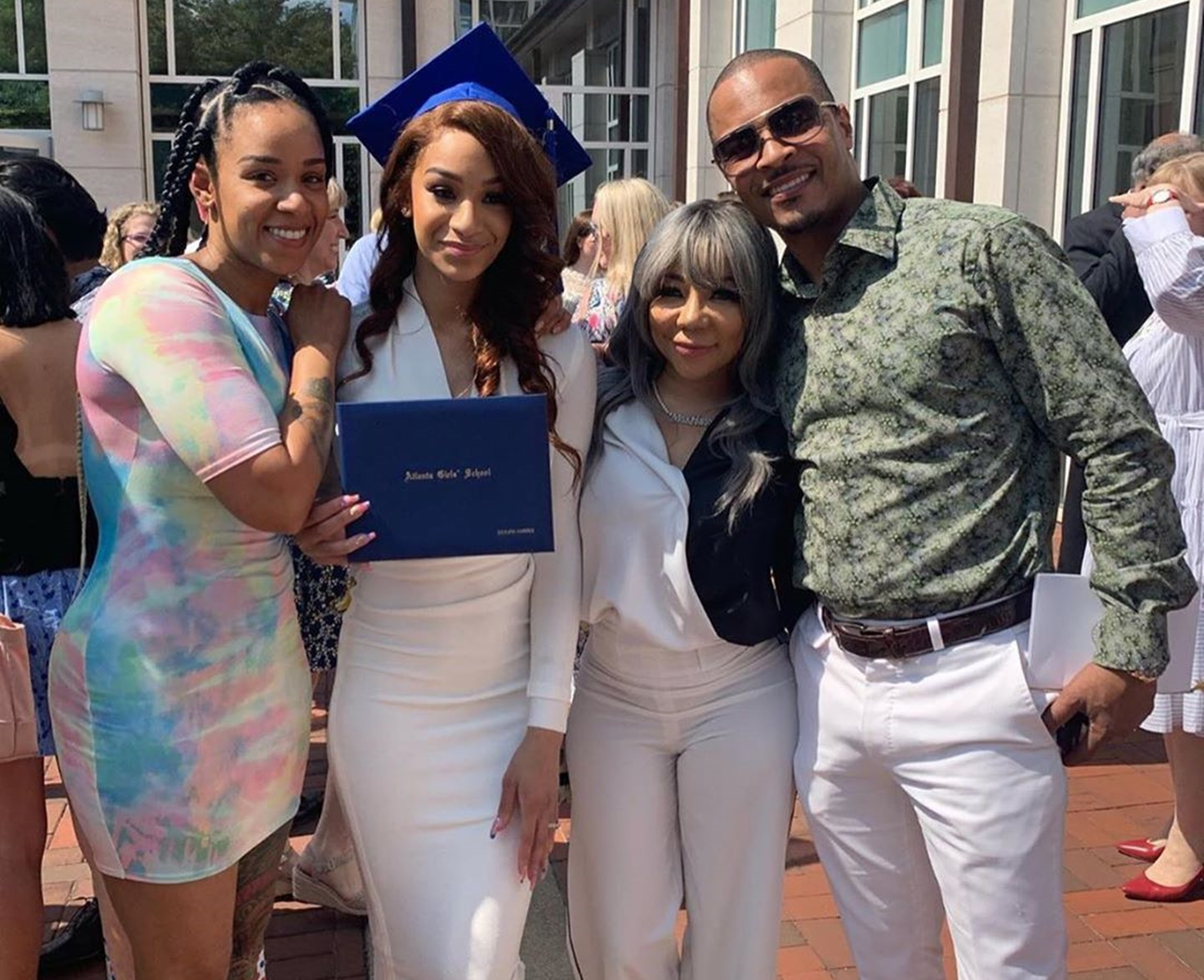 t-i-s-daughter-deyjah-looks-stunning-with-her-two-mothers-at-graduation-ceremony-check-out-why-some-tiny-harris-fans-are-blasting-the-dress-code-fashion-police-criticizing-the-pictures