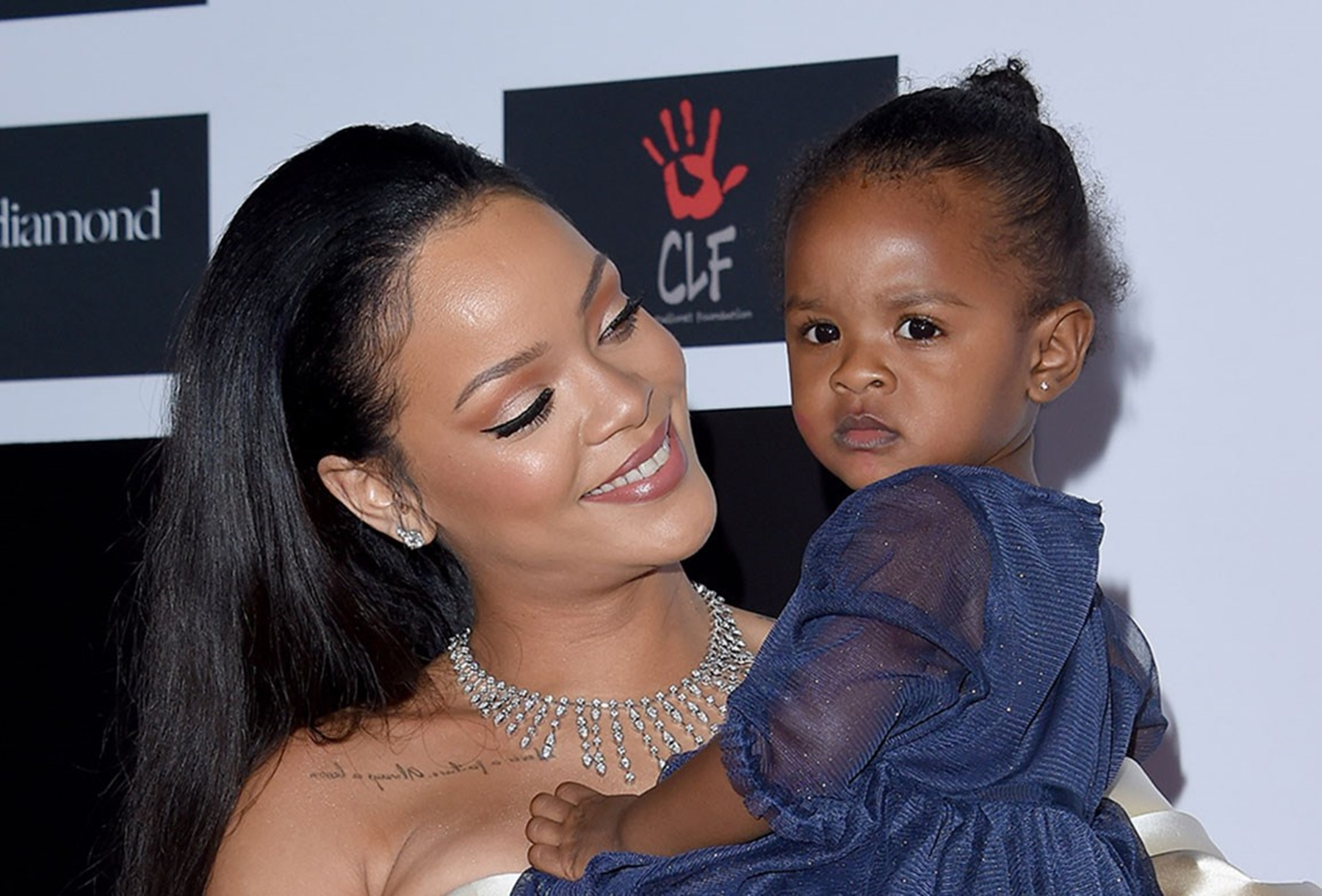 rihanna-sparks-pregnancy-rumor-with-swing-dress-in-cute-video-where-her-niece-majesty-is-taking-a-picture-is-she-making-big-plans-with-hassan-jameel