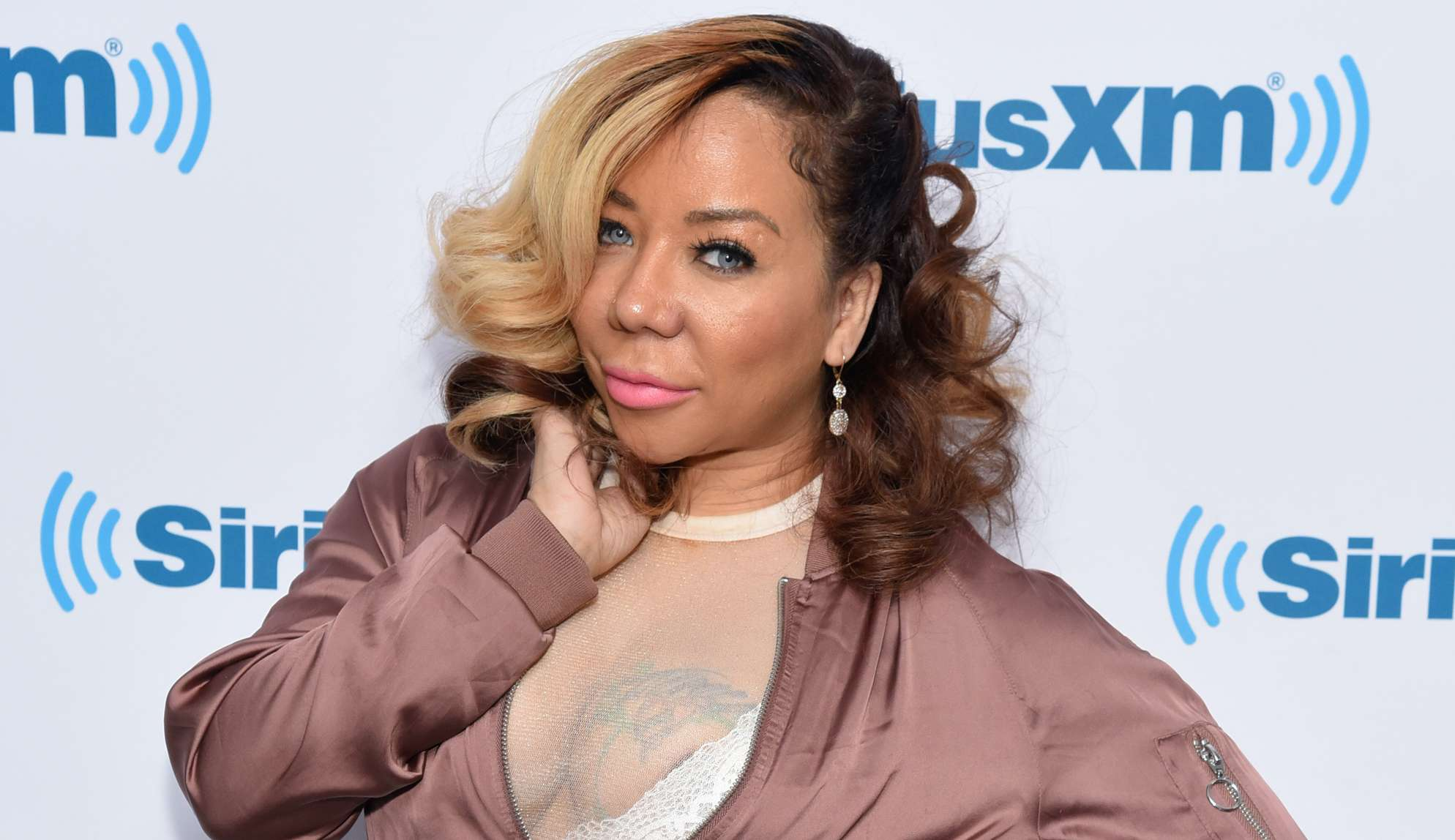 Tiny Harris Rocked A Fashion Nova Skin-Tight Outfit While Celebrating The Release Of Her New Single - Watch The Video