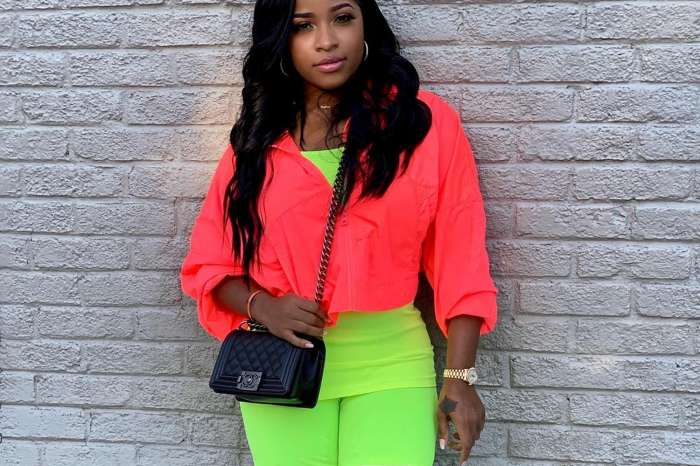 Toya Wright Tries To Look Amazing In Neon Bathing Suit Picture, But Lil Wayne's Ex's Feet Irk Fans