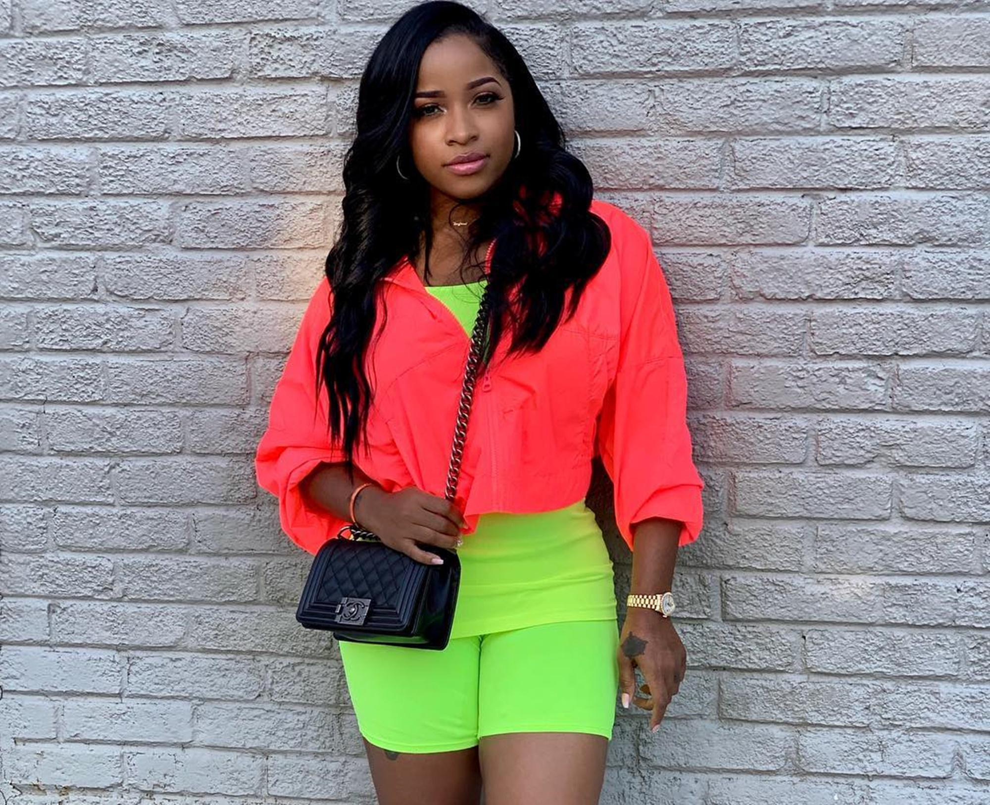 toya-wright-tries-to-look-amazing-in-neon-bathing-suit-picture-but-lil-waynes-exs-feet-irk-fans