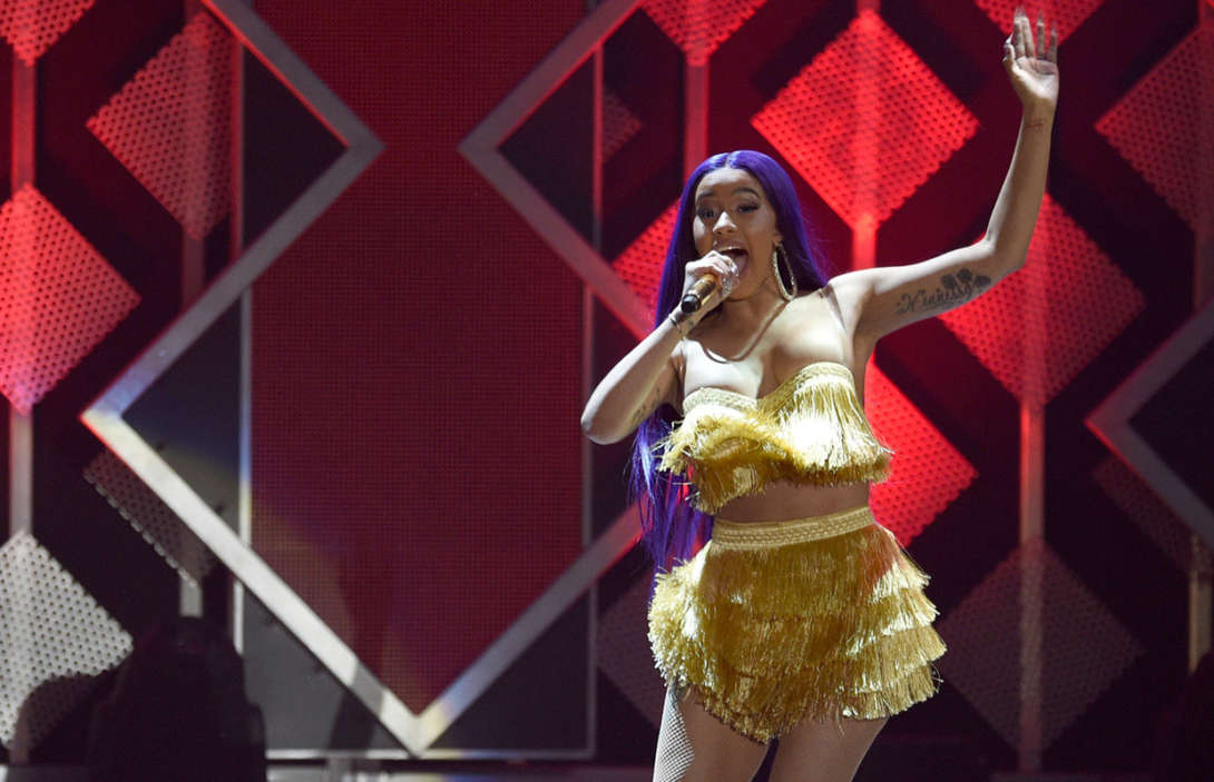 """cardi-b-performs-in-bathrobe-at-bonnaroo-after-her-costume-rips-on-stage"""