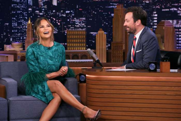 Chrissy Teigen Sparkles On The Tonight Show Starring Jimmy Fallon In Gorgeous Green Dress And Perla Pumps
