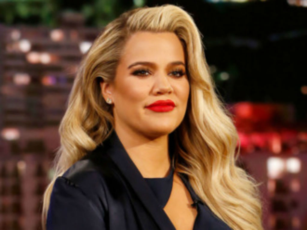 Khloe Kardashian attends her first high school prom with a fan