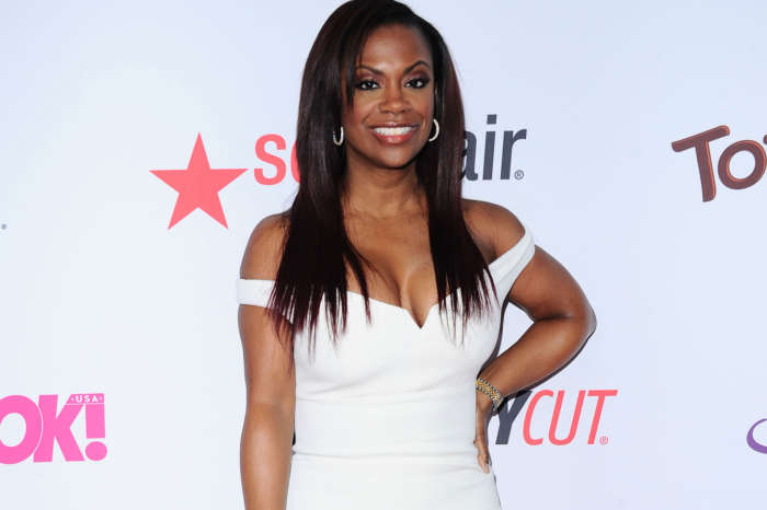 Kandi Burruss Shows Off A Massive Cleavage While Enjoying The Outdoors