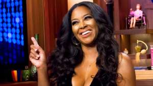 Kenya Moore Poses In A Gorgeous Orange Dress And Her Fans Are In Awe