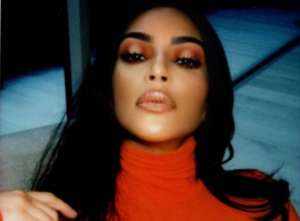Kim Kardashian West Glows In Orange In New Photos