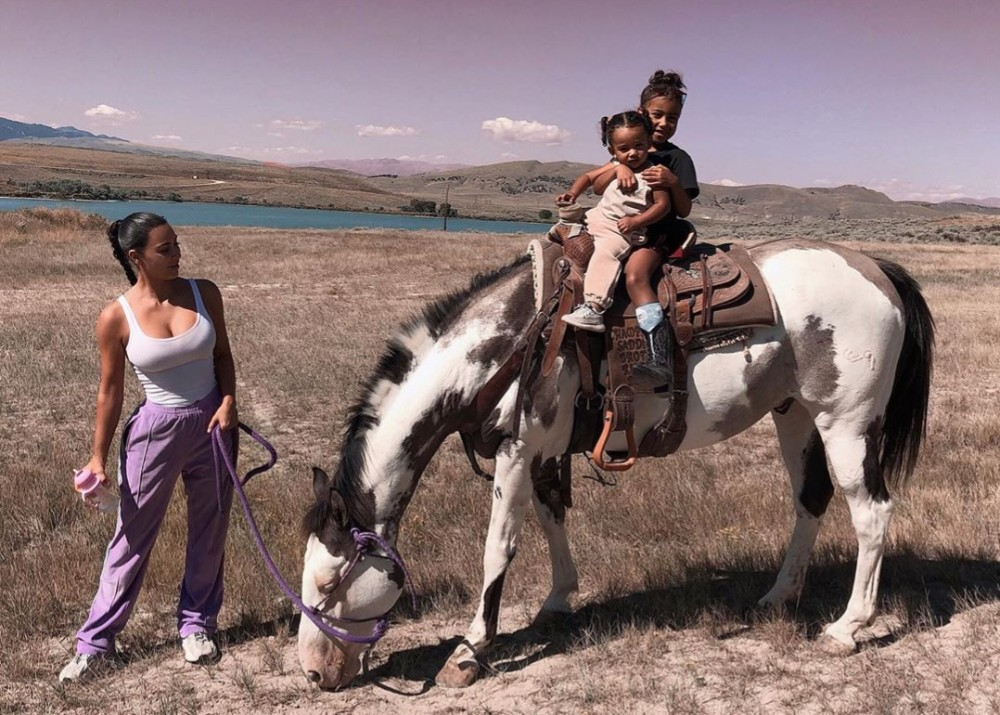 """kim-kardashian-shares-photos-of-north-and-chicago-horseback-riding-on-kanyes-new-wyoming-ranch"""