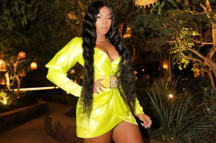 Ashanti Plays With Her Bathing Suit In New Alluring Pictures -- Find Out Why Two Suns Are Shining On Her