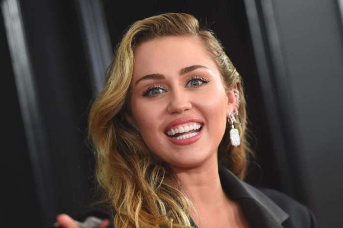 Miley Cyrus Shows Off Her New Bleeding Heart Tattoo - Inspired By Her New Romance With Cody Simpson?
