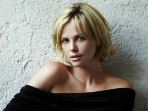 Charlize Theron Jokingly Reveals She Stole Her Pixie Cut Idea From Megan Rapinoe