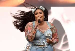Lizzo Lawsuit: Postmates Driver That Lizzo Blasted Is Suing Her!