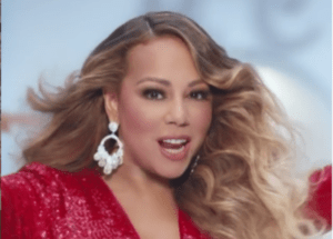 Mariah Carey Releases Merry Christmas (Deluxe Anniversary Edition), Launches Tour, And Poses With Millie Bobby Brown, Blake Lively, And Ryan Reynolds