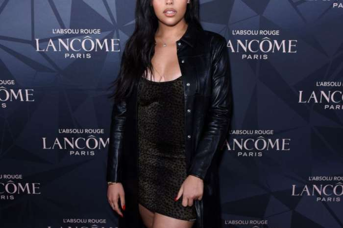 Jordyn Woods Flaunts Her Hourglass Figure In This Ugly Christmas Sweater-Dress