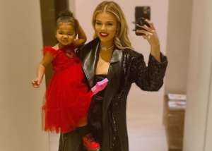 Khloe Kardashian And True Thompson Are Holiday Ready In New Adorable Photos — Khloe Wears Anouki Fake Leather Coat