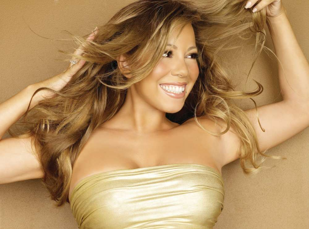 """mariah-carey-becomes-first-artist-to-top-billboards-artist-100-across-four-decades"""