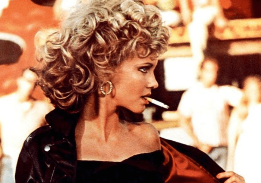 Olivia Newton John's Iconic Leather Jacket From Grease Sells For $234K At Auction, You Won't Believe What Happened Next