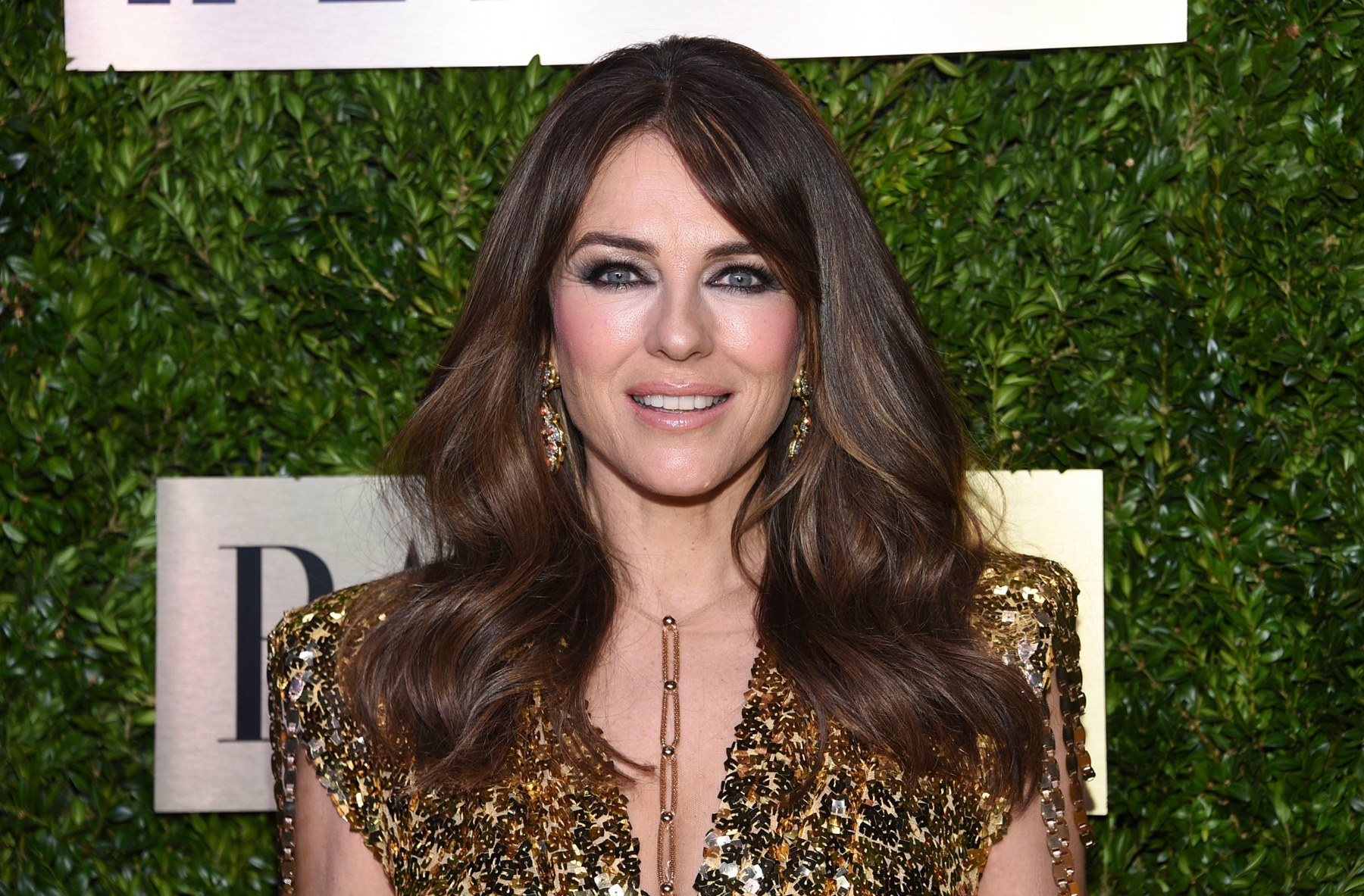 """""""elizabeth-hurley-is-age-defying-in-a-skimpy-bathing-suit-while-riding-a-bike-in-new-video"""""""
