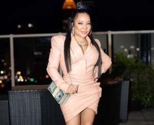 Tiny Harris Is Glowing From Inside In A Yellow Dress That Highlights Her Curves - See The Video