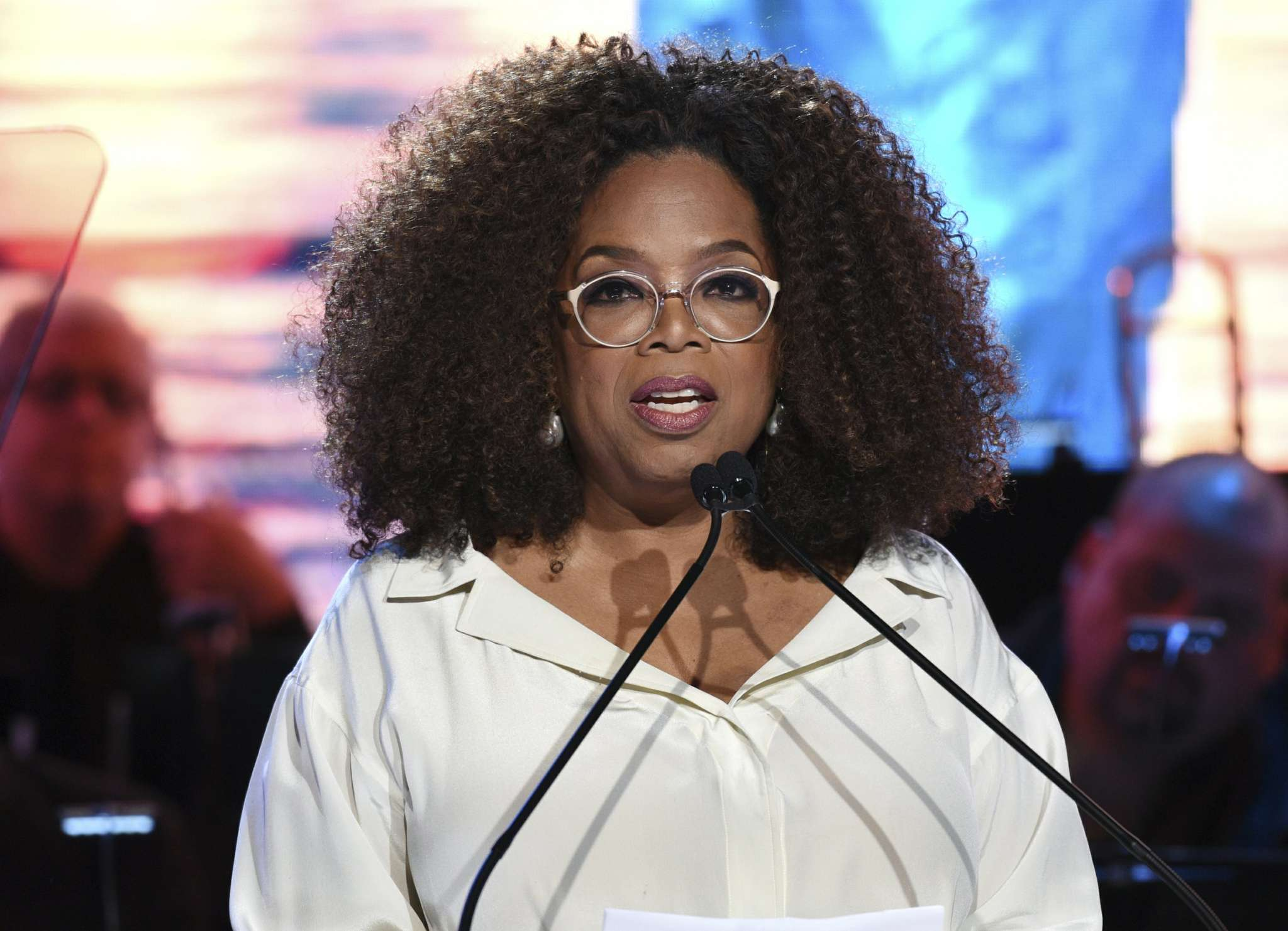 Oprah falls on stage during a speaking event in LA