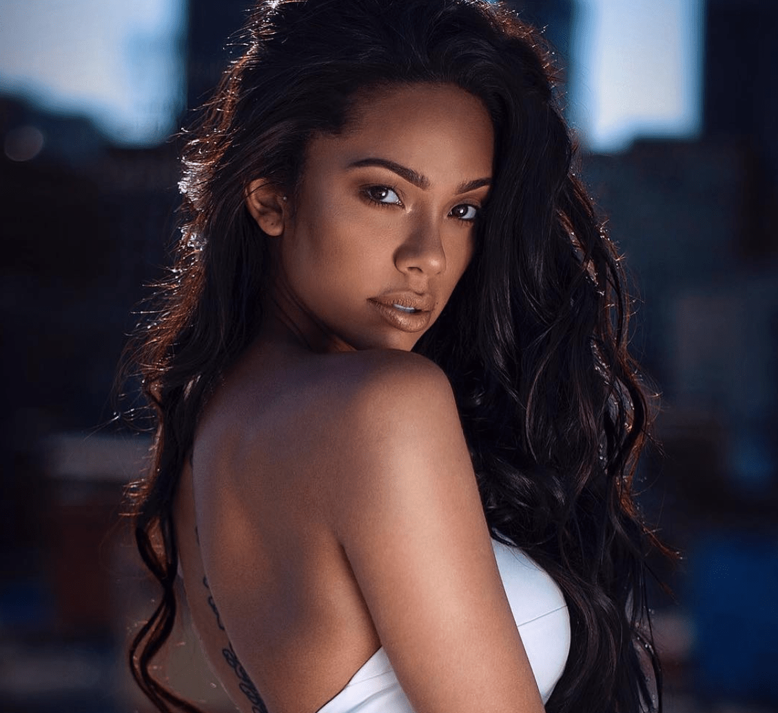 Erica Mena Shows Off Her Mask, But All Fans See Is Her Jaw-Dropping Cleavage - Some Haters Accuse Her Of Disrespecting Safaree