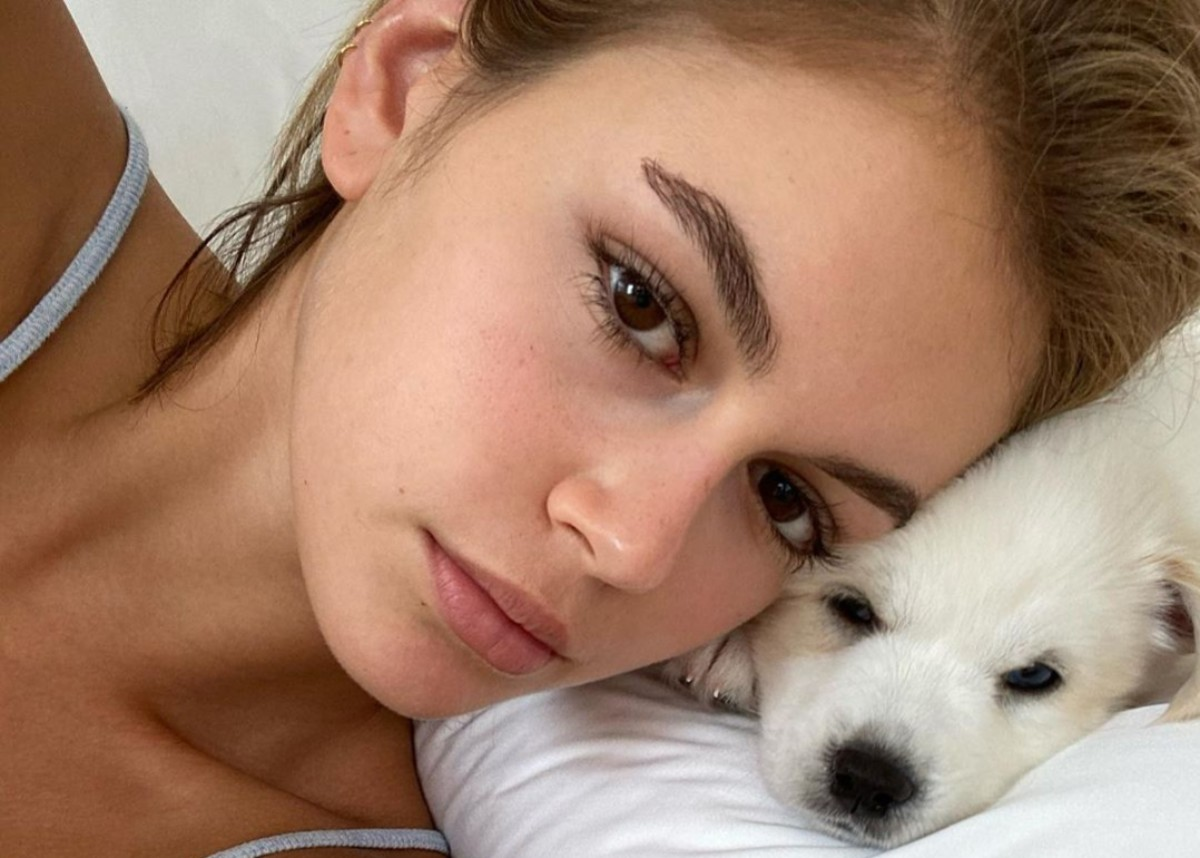 kaia-gerber-wears-a-two-piece-bathing-suit-and-snuggles-two-cuddly-puppies-as-shes-photographed-without-her-cast