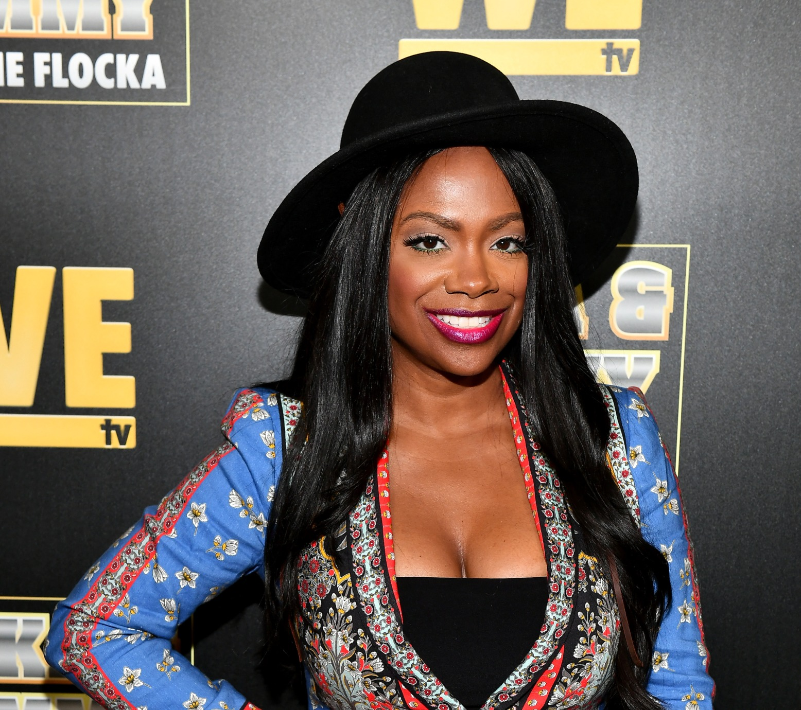 Kandi Burruss Drops Her Clothes And Flaunts Fire Red Hair For Some Racy Photos In Bed - See The Footage And Pics