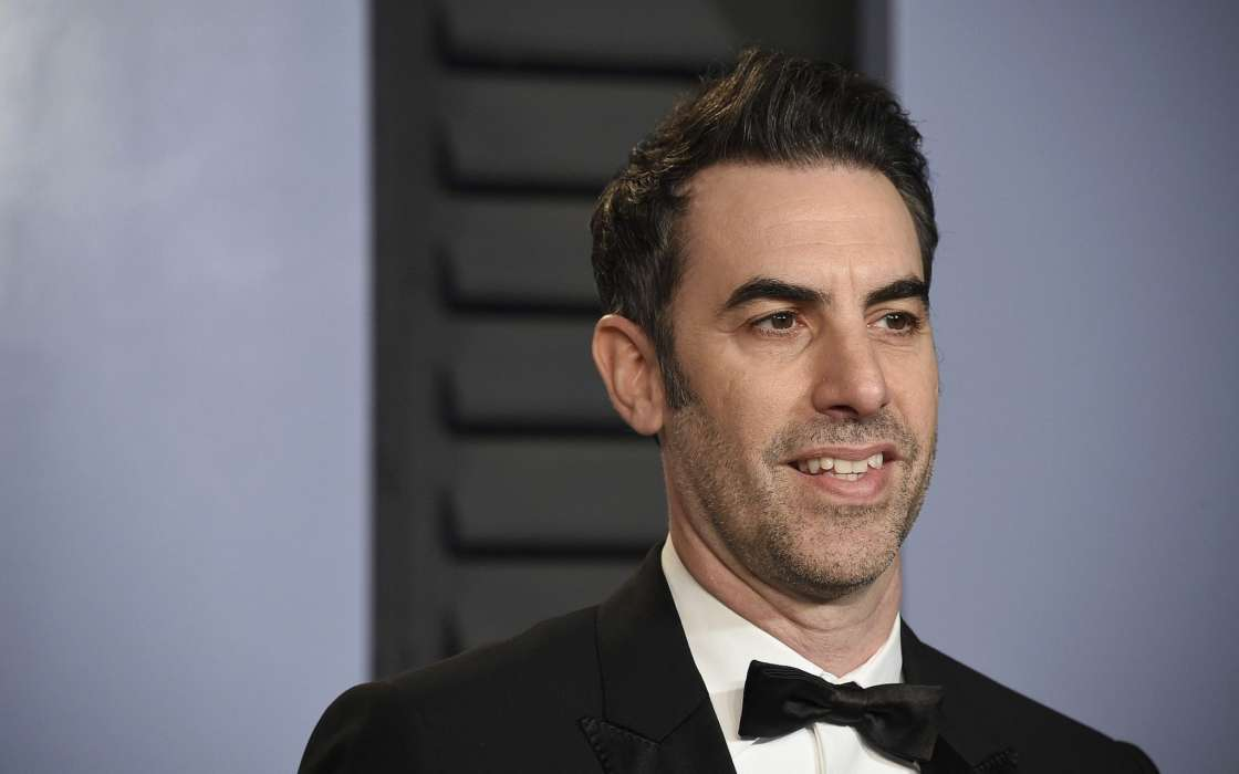 sacha-baron-cohen-invades-political-activist-event-and-sings-racist-song