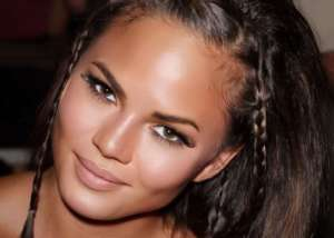 Chrissy Teigen Goes Viral For Cooking In A Montce Swim Two-Piece Bathing Suit