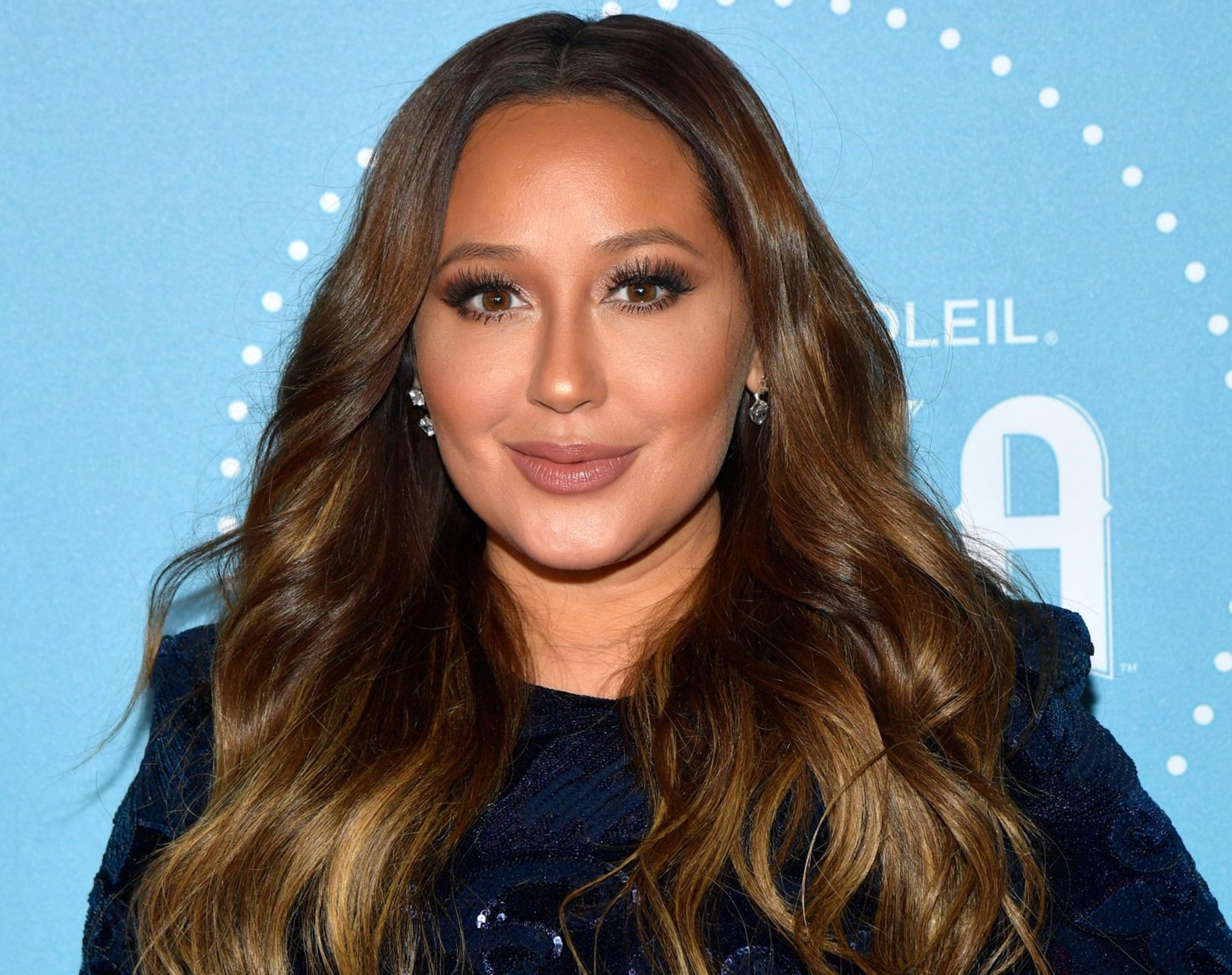 """adrienne-bailon-shares-bathing-suit-photos-to-flaunt-dramatic-weight-loss"""