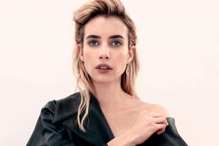 Emma Roberts Shows Off Burgeoning Baby Bump In Black Mini Dress