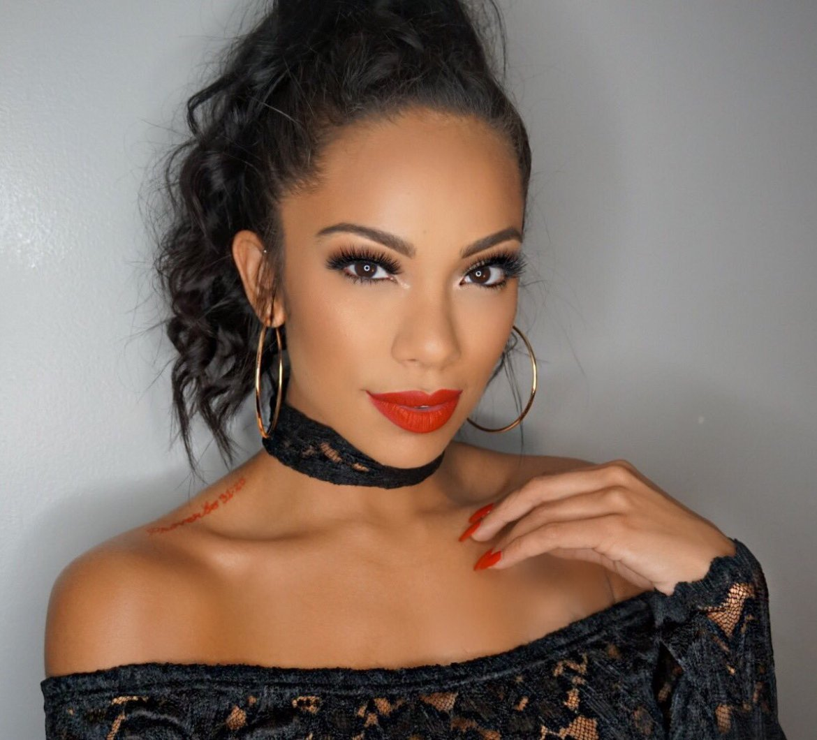 Erica Mena Shows Off Her Secret For Keeping Her Glow This Summer
