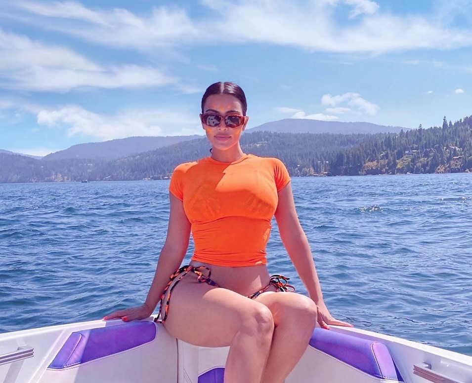 kim-kardashian-looks-amazing-in-wetsuit-while-on-paddleboarding-trip-with-north-west-see-her-photos