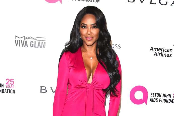 Kenya Moore Flaunts Her Jaw-Dropping Curves In This Peachy Figure-Hugging Dress