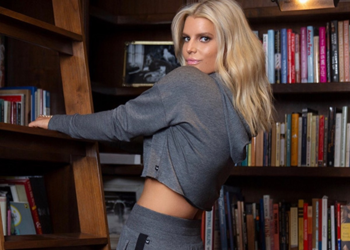 jessica-simpson-models-her-new-fall-collection-cropped-hoodie-and-gorgeous-boots