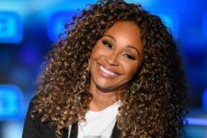 Cynthia Bailey Flaunts Her Long Blonde Locks In This Black Outfit