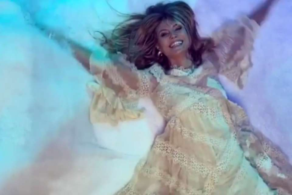 Heidi Klum Looks Like An Angel In New Video