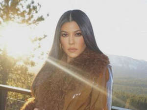 Kourtney Kardashian Glistens In Glossy Leather Coat