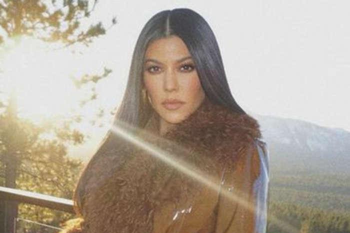 Kourtney Kardashian Glistens In Glossy Leather Coat