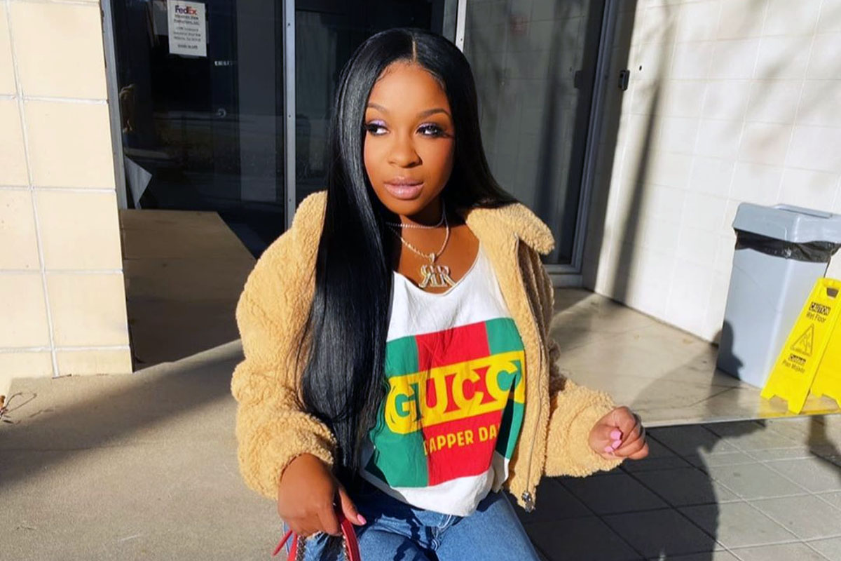 Reginae Carter Wishes A Happy Birthday To Robert Rushing And All Fans See Is Her Bold Look In The Family Photo