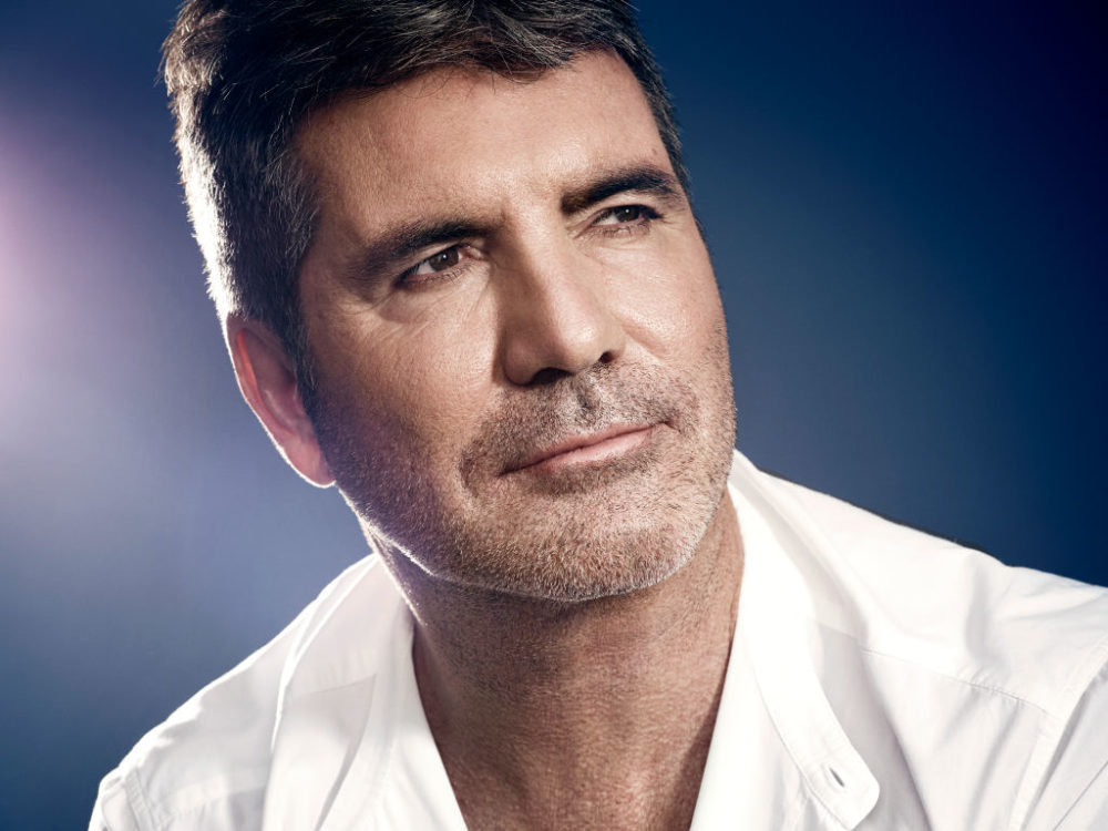 """simon-cowell-puts-an-end-to-2020-with-a-large-scar-on-his-back-following-e-bike-injury"""