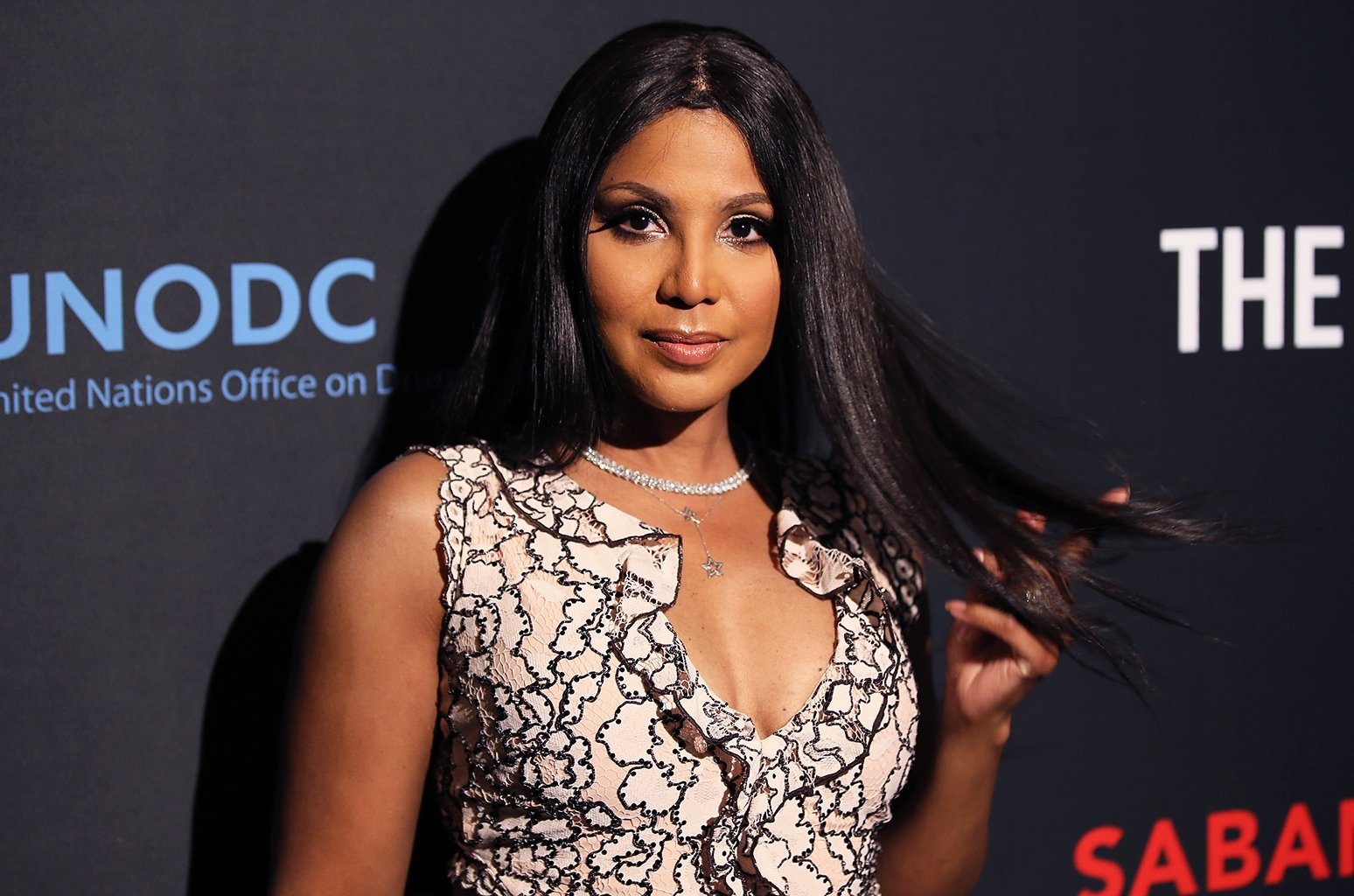 Toni Braxton Flaunts Her New Blonde Short Hair And Rocks This Red Dress