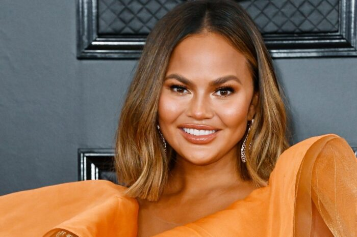 Chrissy Teigen Insists Her Massively Swollen Lips Are A Result Of Biting Into An Orange And NOT Lip Injections!